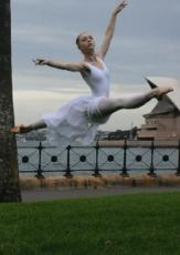Ballet dancer leaping in front of the Sydney Opera House